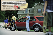 Poster: Teen's risk of dying in a car nearly doubles when a male passenger is present.