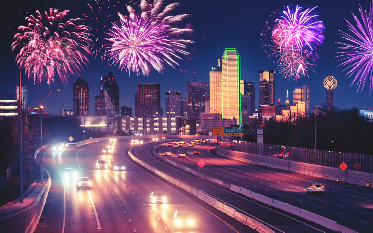 Fireworks, city skyline, cars on interstate