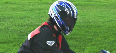 Motorcyclist wearing a helmet