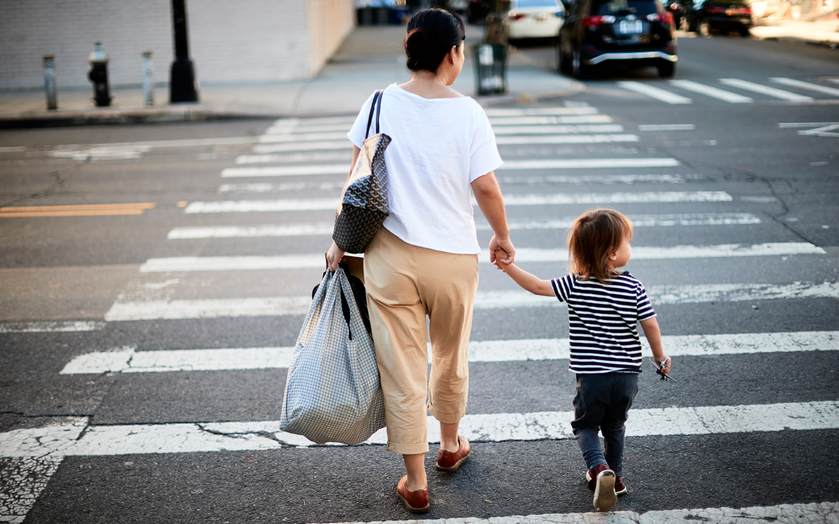Woman and child crossing a street