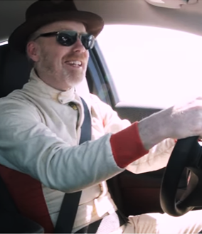 Adam Savage sitting in a car