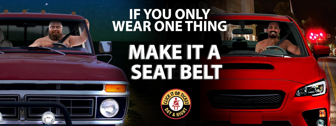 Two shirtless men wearing seat belts, text reads: if you only wear one thing, make it a seat belt