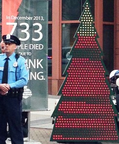 Christmas tree with 733 lights representing how many people died in a drunk driving-related crash in December 2013
